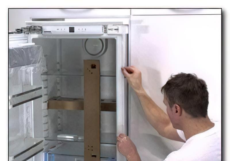 Як переставити двері холодильника 11