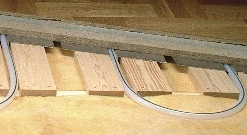 Як зробити теплу підлогу в дерев'яному будинку: варіанти пристрою і монтажу 7