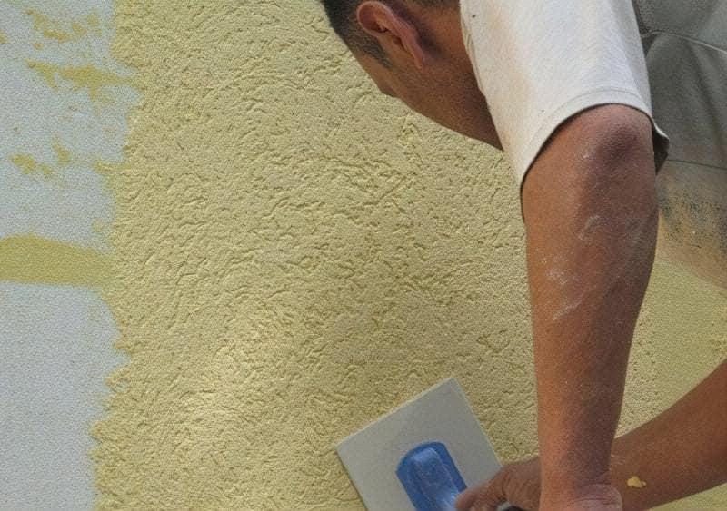 Нанесення декоративної штукатурки на стіну